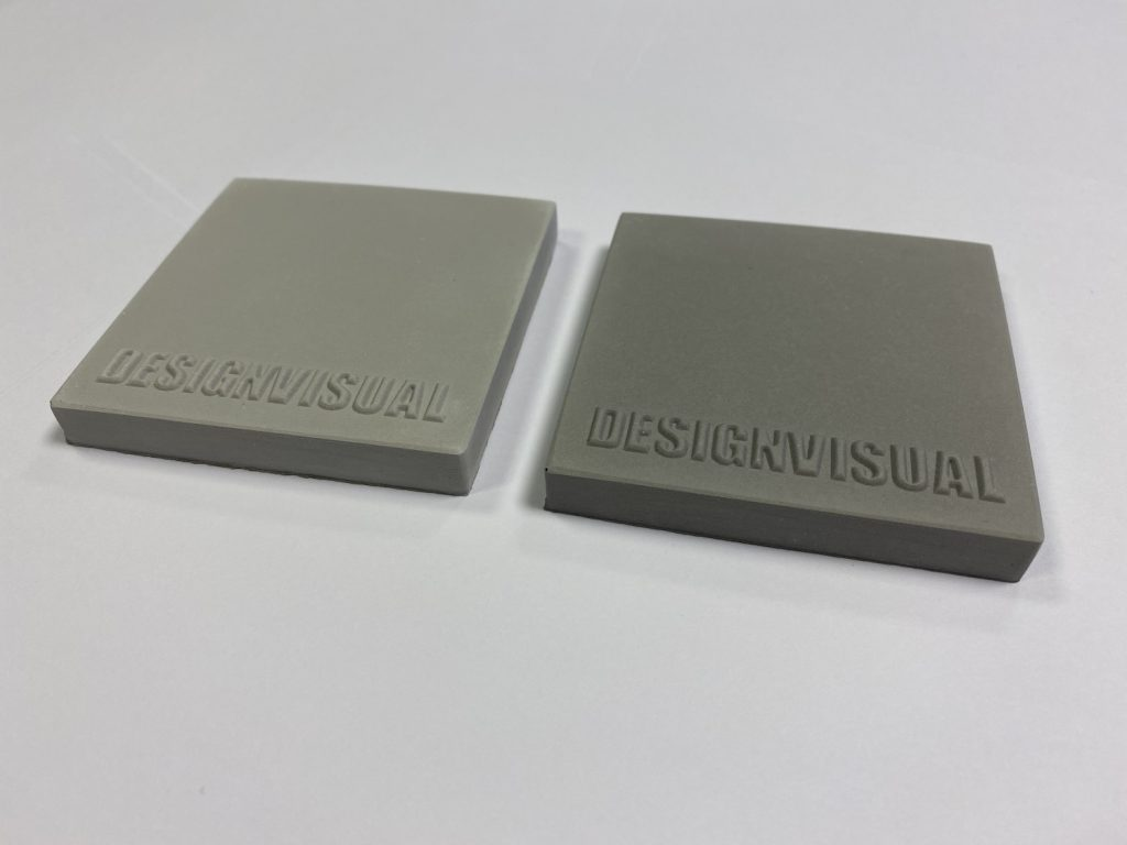 image of two grey colour Jesmonite samples